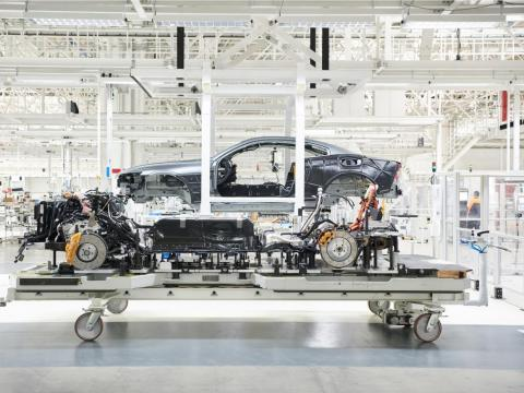 The production facility also includes a test track and an atrium that has panoramic views of the factory.