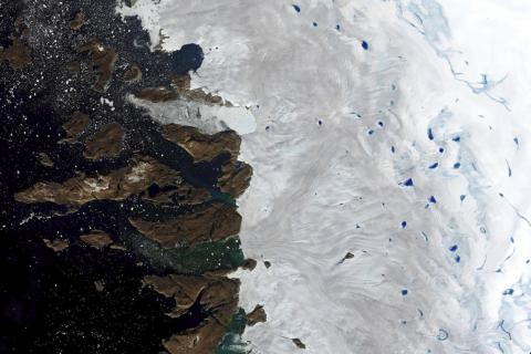 A satellite image shows melt-water ponding on the surface of the ice sheet in northwest Greenland, near the sheet's edge, on July 30, 2019.