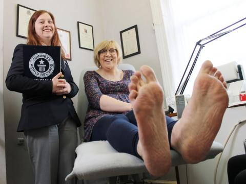 """Trying to find shoes that fit is pretty much impossible,"" Julie Felton said in a video from Guinness World Records."