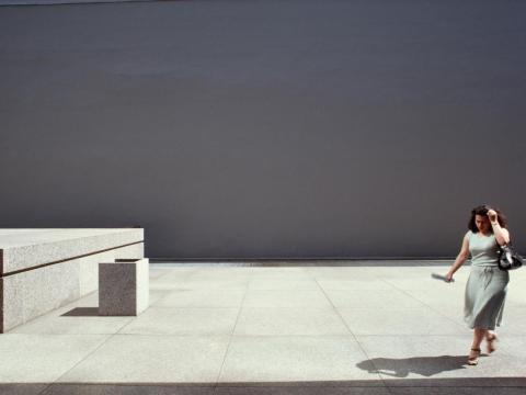 1970s: A woman walks across a sidewalk in Toronto, Canada.