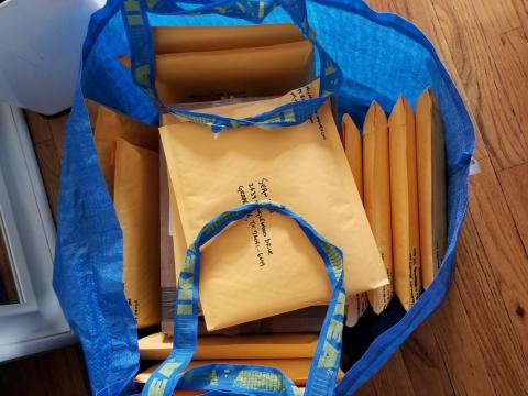 Around 9 a.m., Sabatier heads to the local post office to mail signed copies of his book. He typically ships out about 40 copies every week when he's home. By now, he's used to carting books around — Ikea bags work best, he said.