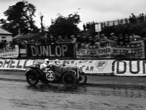By the early 1920s, Enzo landed a job at Alfa Romeo as a race car driver. Fellow drivers at the company included legendary aces like Tazio Nuvolari, seen here in an Alfa.