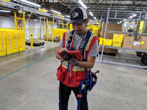 """But even robots make mistakes — products fall to the floor and must be picked up. And that's when you turn to this gentleman here and his team of """"Amnesty Tech."""""""