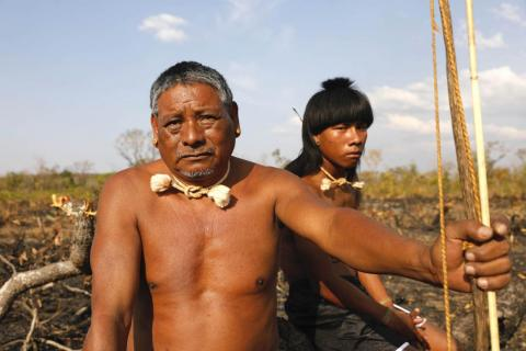 In front sits Chief Hector, 53. They are part of the Xavante tribe. In total, there are about 20,000 Xavante people across Brazil. They live in a tribe of around 100.