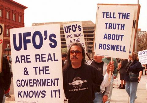 A group of protesters marches in front of the General Accounting Office (GAO) in Washington, DC on March 29, 1995.