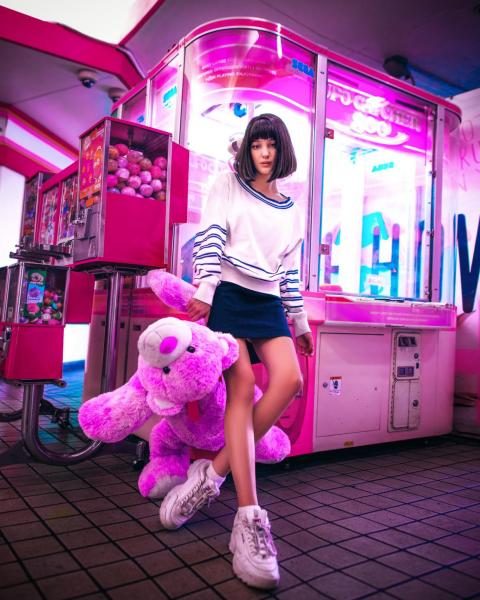 A model posing with a stuffed animal.