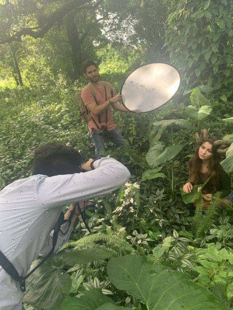 Behind the scenes of the photo shoot.