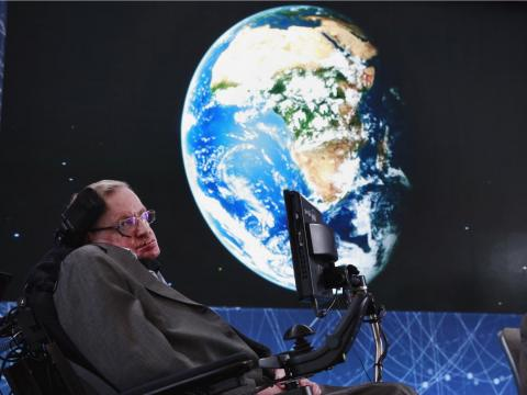 Stephen Hawking sits on stage during an announcement of the Breakthrough Starshot initiative with investor Yuri Milner in New York, April 12, 2016.