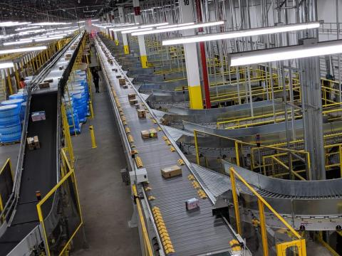 The shipping area seen here was one of the most immediately impressive parts of the facility. Packages are automatically whisked from the conveyor belt to different chutes solely by the metal slats moving from left to right (the