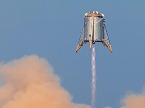 Starhopper — SpaceX's first Mars Starship prototype — hovering over its launchpad during a test flight in Boca Chica, Texas, last Tuesday.