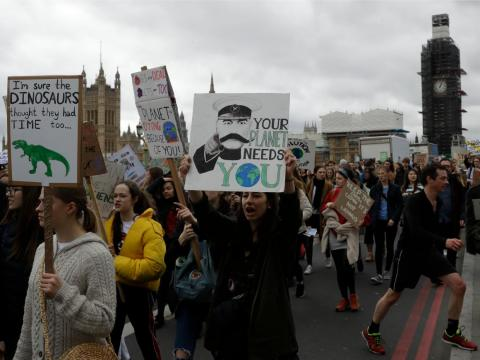 Students march across Westminster Bridge as they take part in a climate protest in London, March 15, 2019.