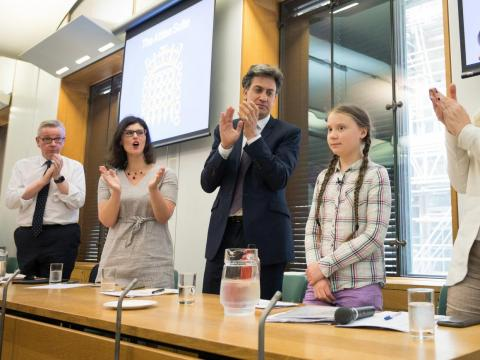 Greta Thunberg meets with former Climate Change Minister Ed Miliband (third from left) and other UK politicians.