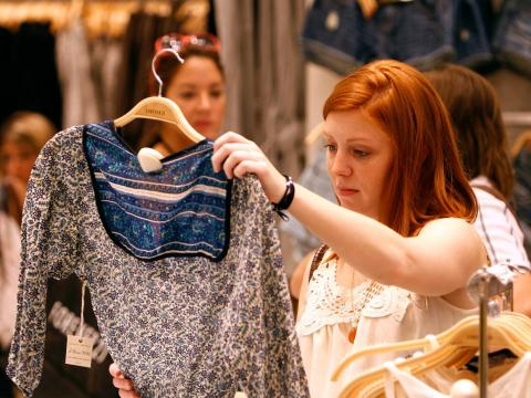 A customer shops during the grand opening of the Forever 21 flagship store in New York's Times Square, June 25, 2010.