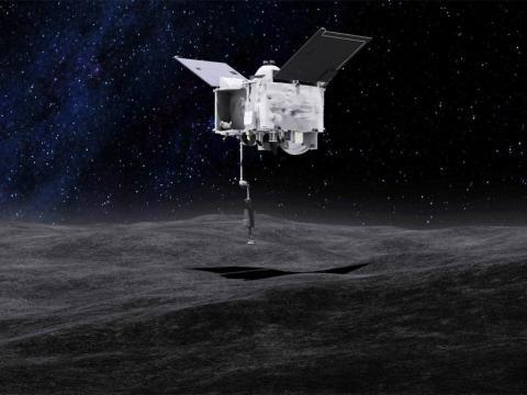 El concepto de este artista muestra la nave espacial OSIRIS-REx recogiendo una muestra del asteroide Bennu. OSIRIS-REx es un primer paso para aprender a minar asteroides.