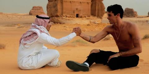 The Instagram star Jay Alvarrez with a Saudi man wearing a keffiyeh and thawb at Saudi Arabia's heritage center of Mada'in Saleh.