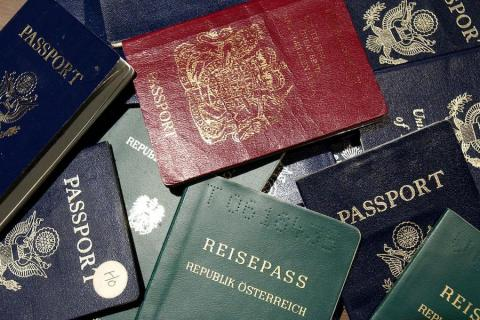 It's illegal to hold two passports in Saudi Arabia.