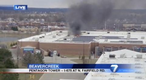Local news channels show a fire at a Walmart in Beavercreek, Ohio, in March 2018.