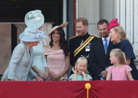 """Meghan Markle married into the royal family in May 2018. Just a month after her wedding to Prince Harry, the royal was criticized for """"breaking protocol"""" with an off-the-shoulder dress at the Trooping the Colour parade."""