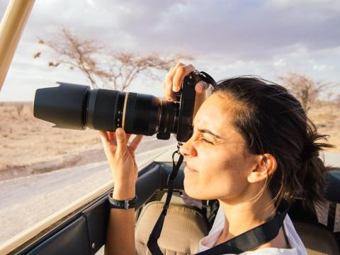 A woman using a camera on Safari.
