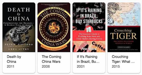 "A selection of White House trade adviser Peter Navarro's books on economics. References to ""Ron Vara"" have been found in ""Death by China"" and ""If it's Raining in Brazil, Buy Starbucks."""