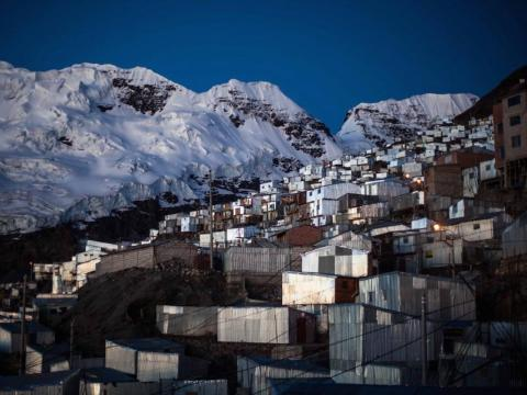 The settlement was built at an astonishing height of 16,700 feet and lies in the shadow of Bella Durmiente — or Sleeping Beauty — an enormous glacier that lurks over the town.