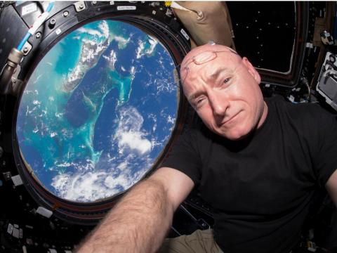 Astronaut Scott Kelly floats inside the windowed Cupola of the International Space Station on March 11, 2016.
