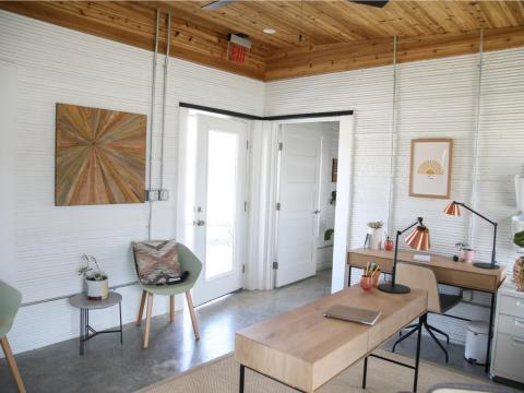 The Vulcan ll was recently used to build a 400-square-foot welcome center for Austin's Community First Village, a project that houses a portion of the city's chronic homeless population.