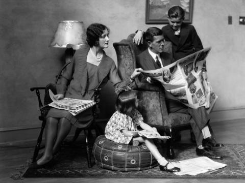 A family reading the paper, circa 1927.