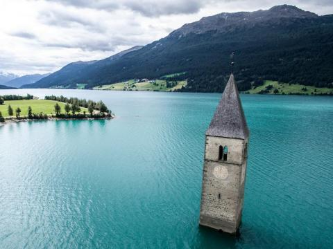 Only the tower of this church still remains above water on Lake Reschen.