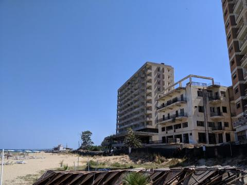 Once popular tourist destinations, these beach side hotels are now vacant.