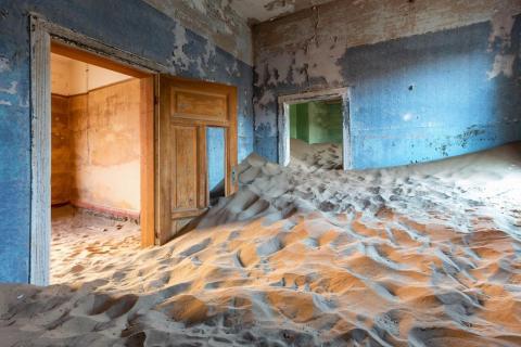 A building invaded by sand dunes in Kolmanskop.