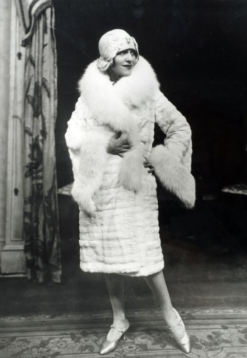 A woman wearing a fur coat and hat in the '20s.
