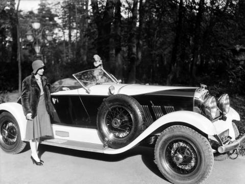 A woman with a Chrysler vehicle, circa 1920s.