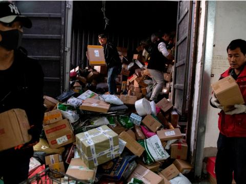 Photos show Singles Day packages piling up in warehouses in Beijing, China, and some warehouses look more crowded than others.