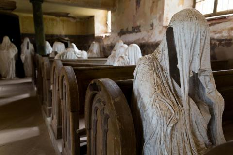 Ghostly figures line the pews in St. George's Basilica.