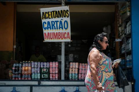 "A store shows a placard reading ""Mumbuca card accepted"" in Marica, Brazil."