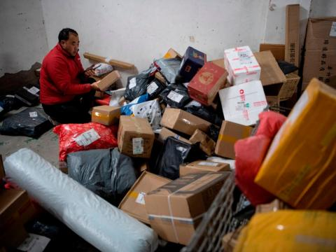 Workers in chaotic-looking warehouses appear to be struggling to keep up with the large number of Singles' Day orders.