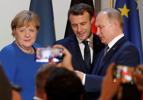Angela Merkel, Emmanuel Macron y Vladimir Putin