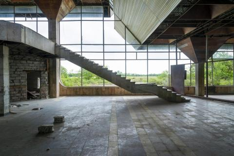 Concrete staircases leading to an empty upper level were some of the only structures I saw standing.