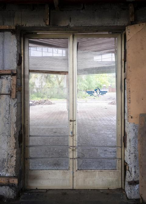 The decaying entrance to the airport was a sign of what was to come.