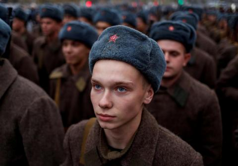 In November, a Russian Army member, dressed in historical uniform, looks on before a rehearsal for a military parade to mark the anniversary of a historical parade in 1941, when Soviet soldiers marched towards the front lines at