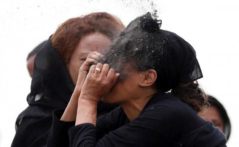 A relative puts soil on her face as she mourns at the scene of the Ethiopian Airlines Flight ET 302 plane crash, near the town Bishoftu, near Addis Ababa, Ethiopia, on March 14.
