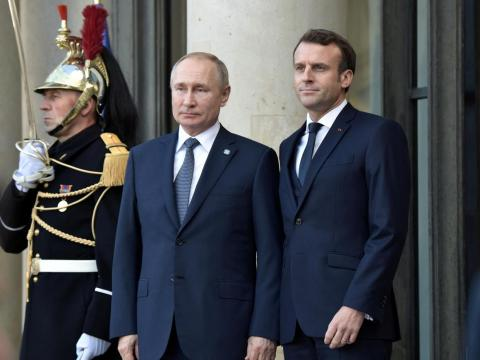 Russian President Vladimir Putin with French President Emmanuel Macron.