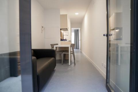 Salón pequeño del edificio de Alojamientos de Proximidad Provisionales (APROP).