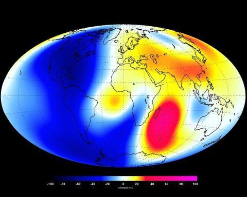 Una foto del campo magnético de la Tierra. Los tonos rojos muestran las áreas donde el campo es más fuerte, y los tonos azules muestran las áreas que son más débiles.