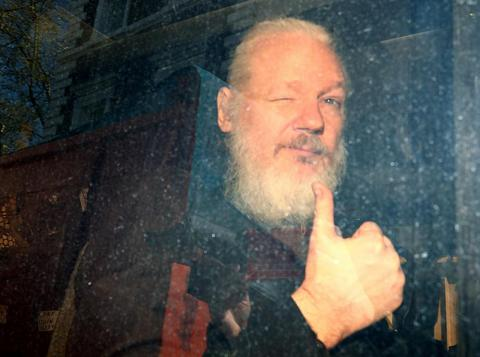 WikiLeaks founder Julian Assange arrives at the Westminster Magistrates Court after he was arrested in London on April 11, following several years of living inside the Ecuadorian embassy, near the famed Harrods department store.