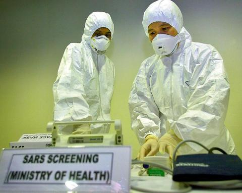 A doctor checking equipment at a SARS screening room at Kuala Lumpur International Airport in Malaysia in 2003.