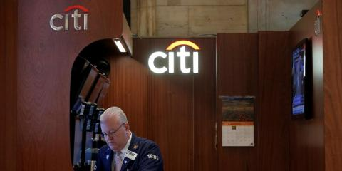 Citi trader Thomas Ferrigno works in his company's booth on the floor of the New York Stock Exchange (NYSE) in New York City, U.S., July 27, 2016.