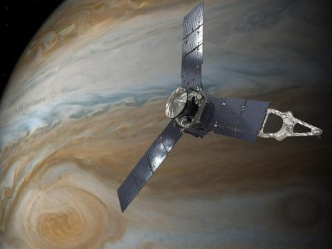 Una ilustración de la sonda Juno de la NASA en Júpiter.
