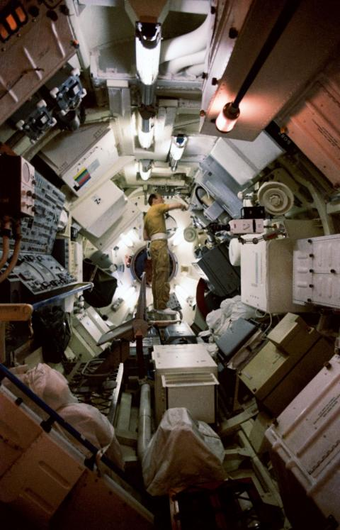 The first US space station was called Skylab; this photo shows its interior chamber. The station included a workshop and solar observatory, and it housed hundreds of science experiments.